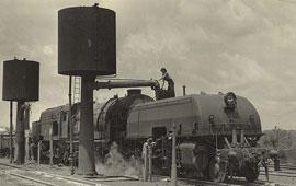 Class AD6002 Garratt locomotive taking water at Valley Heights. Digital ID 17420_a014_a014000240